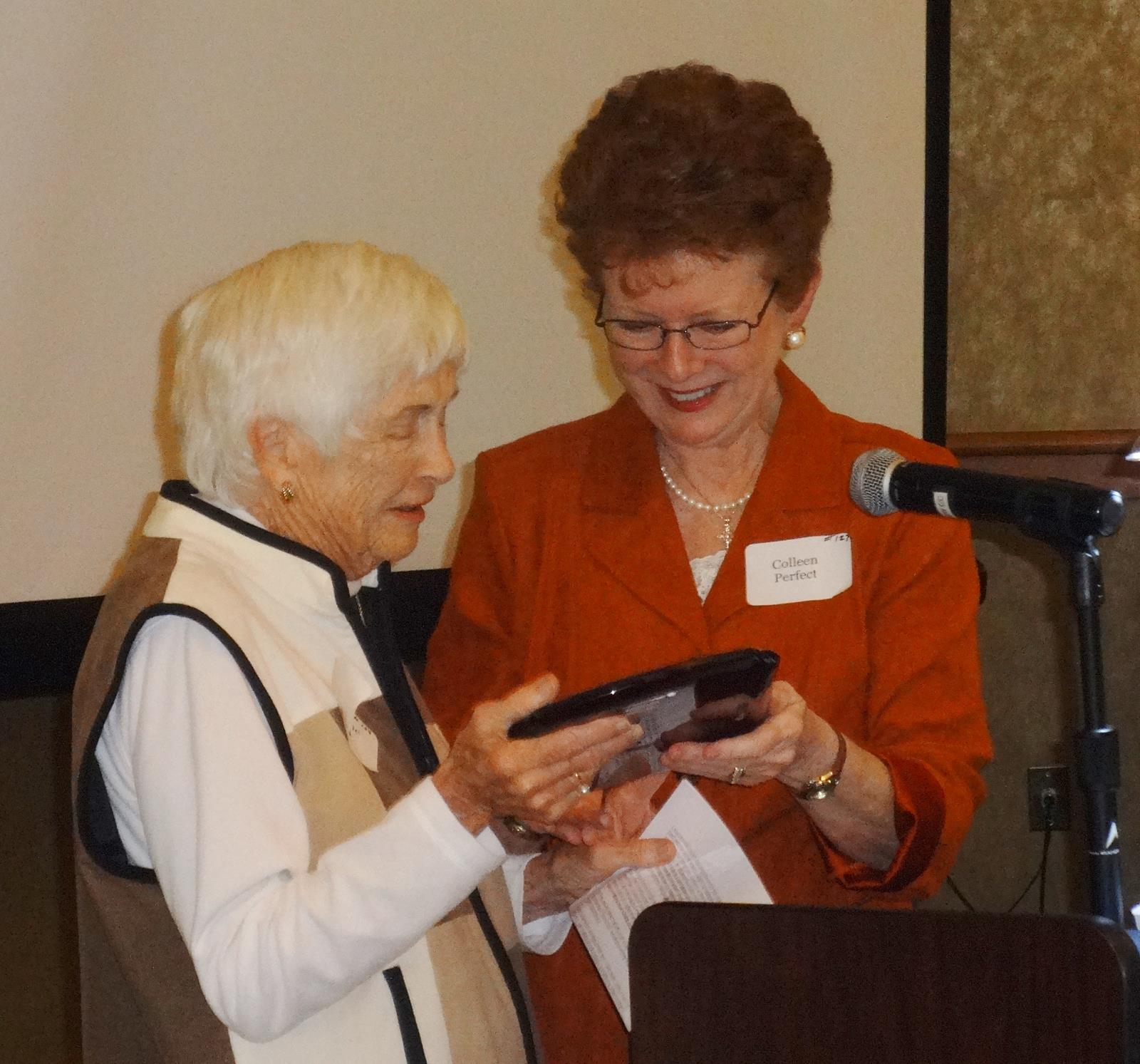 Colleen Perfect, President of CPO presenting Marlene Reid with the 2015 Arthur A. Herkenhoff award.